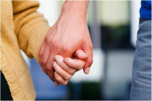 adults holding hands